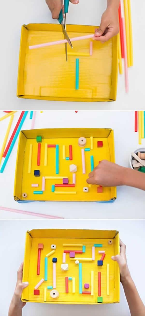 Labirinto com canudos e caixa de papelão