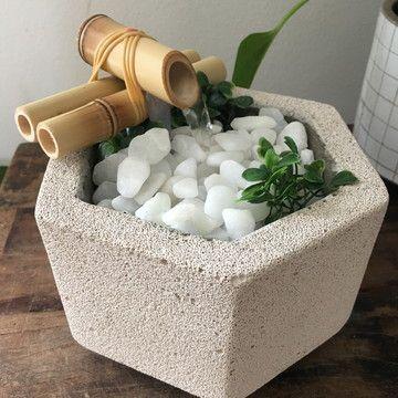 fonte em bloco de cimento